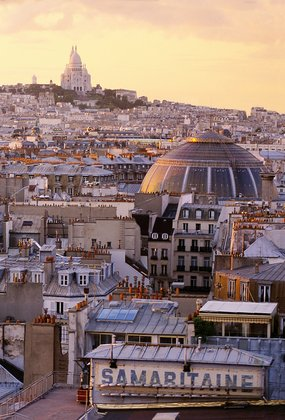 Aerial view over Paris, looking north over rooftops towards Montmartre at dusk