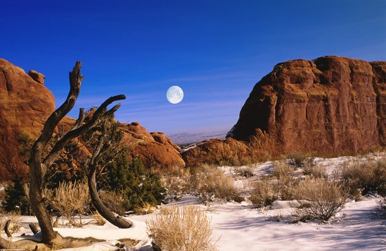 Near Moab, full moon over snow covered desert