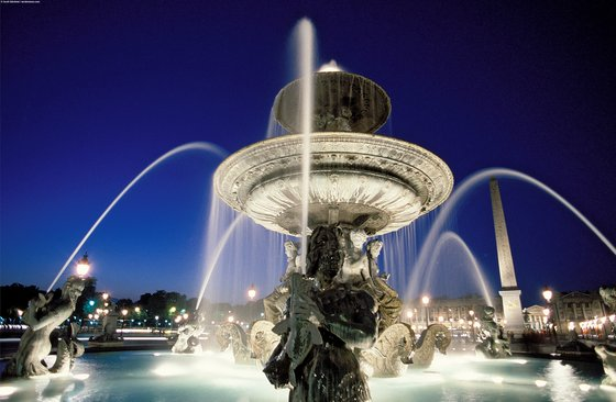 Scenic night view of one of the Fontaines de la Concorde at play