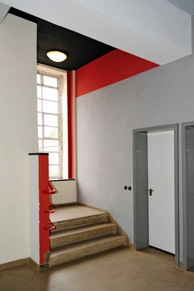 Student hostel, stair interior, showing tripartition of the ceiling colors in black and red with white walls